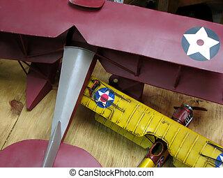Vintage Toy Airplanes - Vintage toy airplanes on wooden...