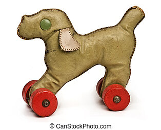 vintage toy dog with red wheels on white background