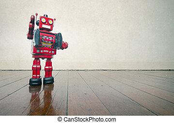 vintage toys - vintage robot toy standing on a wooden floor...