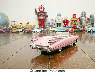 vintage toys - classic pink cadillac, toy on wooden floor