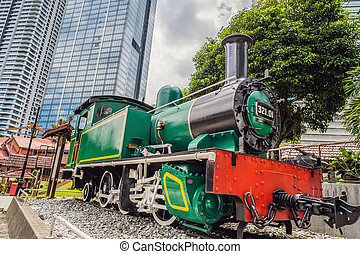 Vintage train on the background of skyscrapers in Malaysia Kuala Lumpur