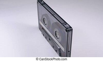 Vintage Transparent Audio Cassette Rotates on White...