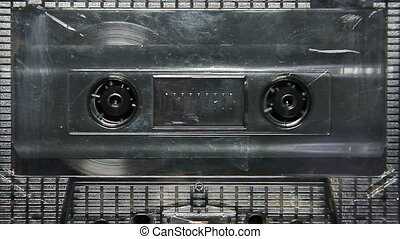 vintage transparent audio cassette tape in the deck
