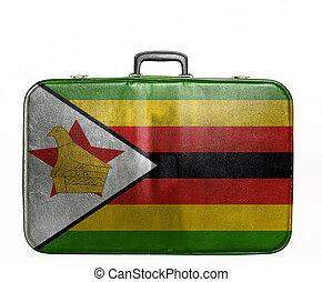 Vintage travel bag with flag of Zimbabwe