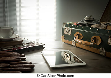 Vintage travel equipment on table