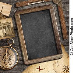 Vintage treasure map, blackboard with copyspace, old compass...