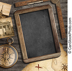 Vintage treasure map, blackboard with copyspace, old compass...