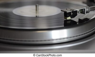 vintage turntable playing vynil, sliding camera movement