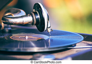 Vintage turntable with vinyl disc