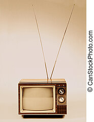Vintage TV with antenna over a sephia background.