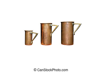 Vintage, two large and one small cup for drinks made of copper and brass, isolated on a white background with a clipping path.