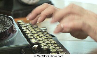 Vintage Typewriter - Woman types on vintage typewriter