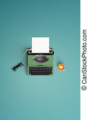 vintage typewriter with hot coffee cup on the color background