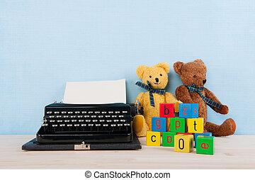 Vintage typewriter with old toys