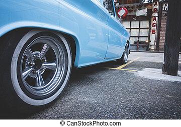 Vintage US classic car selective focus wheel of car