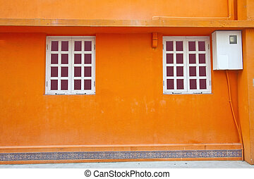 Vintage wall and windows in orange background