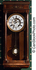 Vintage wall clock in a wooden case.