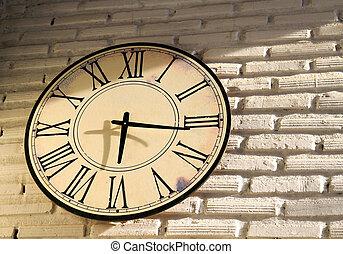 vintage wall clock on brickwall