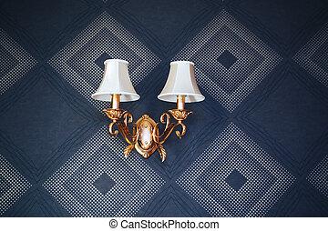 Vintage wall lamp. Dark blue wallpaper