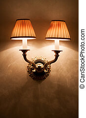 Vintage wall lamp on old textured wall