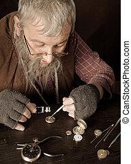 Vintage watch-maker - Old bearded man reparing antique...