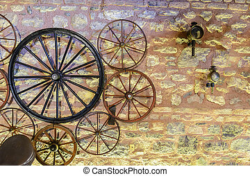 vintage wheels various carts on the background of a stone wall