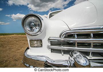 Vintage white car outside. Detail, close-up