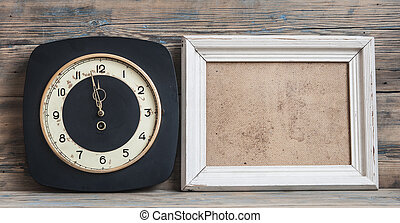 vintage white clock on wooden background