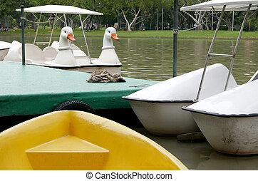 Vintage white duck recreation boat in Thailand park