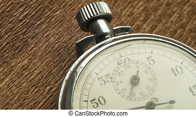 Vintage White Stopwatch on the Brown Structural Background...