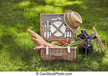 Vintage wicker picnic hamper with beers in cooler