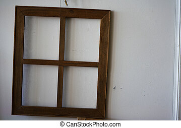 vintage window frame without glass on old white wall