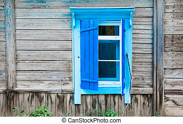 Vintage window of a old wooden house in Russia