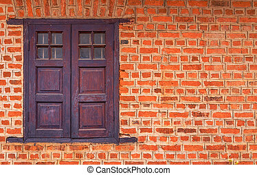 Vintage window on Red brick wall background