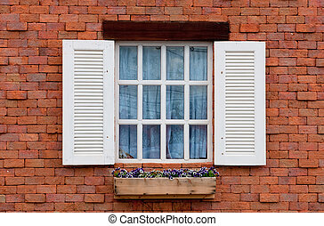 Vintage window on red brick wall