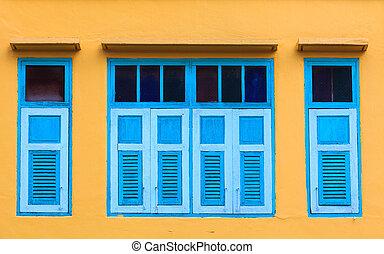 Vintage window on yellow wall