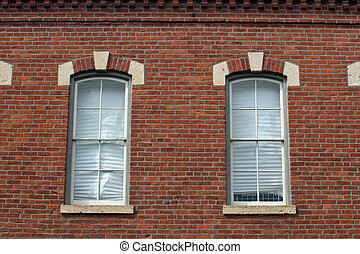 Vintage windows in red brick building