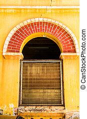 Vintage windows on old brick wall