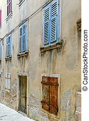 Vintage windows with wood shutters