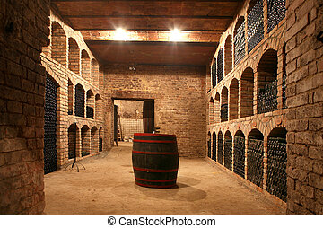 Vintage wine bottles stacked in the old cellar of the winery...