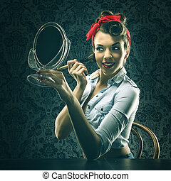 Vintage woman holding a mirror and makeup brush