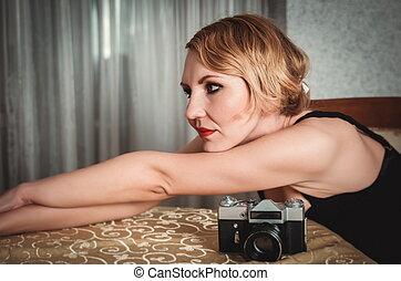 Vintage woman portrait with camera