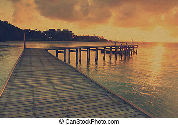 Vintage wood bridge path at beach sunrise