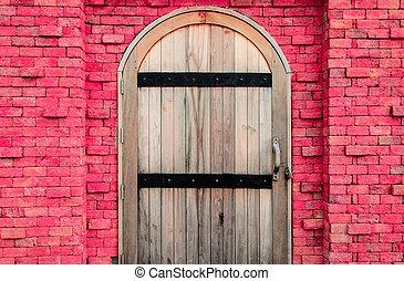 Vintage wood door on brick wall