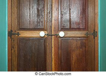 Vintage wood door with white knob