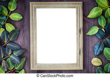 Vintage wooden background with blank frame for the inscriptions