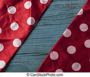 vintage wooden background with red polka dot ribbon