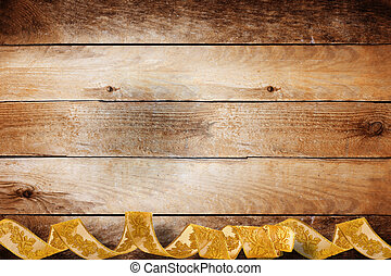 Vintage wooden background with swirling gold braid for...