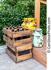 Vintage wooden boxes with craft beer bottles and metal cans