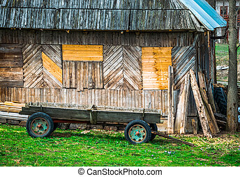 Vintage wooden cart, horse carriage near the house